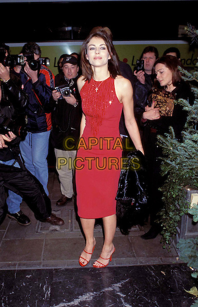 ELIZABETH HURLEY.Ref:8014/0712h.red knee length dress & shoes, press, photographers, paparazzi, Liz, full length, full-length.www.capitalpictures.com.sales@capitalpictures.com.©Capital Pictures