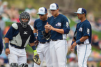 West Michigan Whitecaps (L to R) catcher Arvicent Perez (13), third baseman Steven Fuentes (24), pitcher Eudis Idrogo (26) and shortstop David Gonzalez (10) wait for a coach to arrive on the mound against the Dayton Dragons on April 24, 2016 at Fifth Third Ballpark in Comstock, Michigan. Dayton defeated West Michigan 4-3. (Andrew Woolley/Four Seam Images)