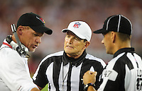 Aug. 22, 2009; Glendale, AZ, USA; NFL referee Ed Hochuli (center) during the game between the San Diego Chargers against the Arizona Cardinals during a preseason game at University of Phoenix Stadium. Mandatory Credit: Mark J. Rebilas-