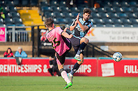 Shaun Brisley of Northampton Town & Max Kretzschmar of Wycombe Wanderers go in for the ball during the Sky Bet League 2 match between Wycombe Wanderers and Northampton Town at Adams Park, High Wycombe, England on 3 October 2015. Photo by Andy Rowland.