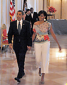"Washington, D.C. - May 12, 2009 -- United States President Barack Obama and first lady Michelle Obama walk to the East Room for ""An Evening of Poetry, Music and the Spoken Word in the East Room of the White House in Washington, DC on Tuesday, May 12, 2009..Credit: Ron Sachs / Pool via CNP"