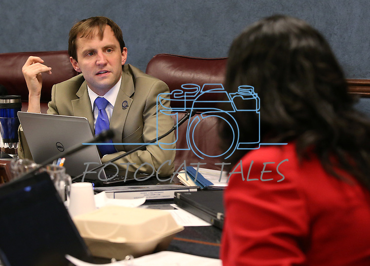 Nevada Assembly Democrats Elliot Anderson and Olivia Diaz work in a committee hearing at the Legislative Building in Carson City, Nev., on Friday, April 10, 2015. <br /> Photo by Cathleen Allison