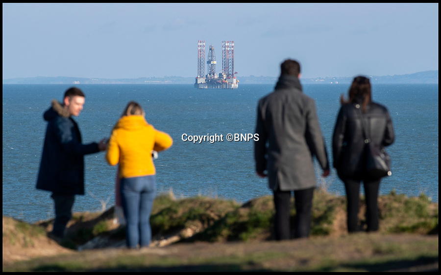 BNPS.co.uk (01202 558833)<br /> Pic: PhilYeomans/BNPS<br /> <br /> Sightseers at Old Harry Rocks on the Jurassic coast near Poole in Dorset.<br /> <br /> Hold your horses - Alarmed conservationists are calling on the government to stop an oil rig drilling operation off the south coast because of the affect it could have on a precious seahorse colony.<br /> <br /> The 100m high platform is currently drilling an appraisal well for oil deep under Poole Bay, Dorset, which forms part of Britain's UNESCO World Heritage Jurassic Coast.<br /> <br /> Shallow areas of the bay are a well known breeding ground for both the native breeds of seahorses which are a heavily protected species.<br /> <br /> But at this time of year the mystical creatures over-winter in deeper waters close to where the ENSCO 72 rig is positioned.