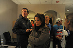 Denis Brogniart, French host of French reality television show Survivor, with his wife Hortense Brogniart prepare to leave the lobby of his hotel with fellow French runners before the Chicago Marathon in Chicago, Illinois on October 11, 2009.