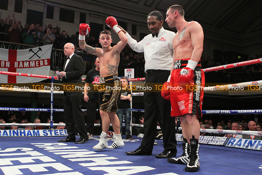 Mitchell Smith (black/gold shorts) defeats Mark Evans in a Super-Featherweight Boxing Contest at York Hall, Bethnal Green, London, promoted by Frank Warren - 22/02/14 - MANDATORY CREDIT: Gavin Ellis/TGSPHOTO - Self billing applies where appropriate - 0845 094 6026 - contact@tgsphoto.co.uk - NO UNPAID USE