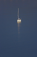 Sailboat on calm water of Drakes Bay. Point Reyes National Seashore. California