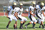 Torrance, CA 09/08/11 - Max MacLeay (Peninsula #5), Triston Martinez (Peninsula #70), Issac Kuo (Peninsula #28) and Marco Catallo (Peninsula #10) in action during the North-Peninsula Junior Varsity Football game at North High School in Torrance.