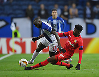 27th February 2020; Dragao Stadium, Porto, Portugal; UEFA Europa League  FC Porto versus Bayer Leverkusen; Moussa Marega of FC Porto is slide tackled along the wing by Edmond Tapsoba of Bayer Leverkusen