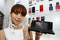 July 15, 2010 - Tokyo, Japan - A booth assistant introduces the NEC N-08B, a communicator' styled handset designed for Japan's NTT Docomo, during the Expo Comm Wireless Japan 2010 - Mobile Power 2010 at Tokyo Big Sight, Japan, on July 15, 2010. The event held from July 14 to July 16, attracts around 37 000 professional buyers and 180 exhiting companies from 10 countries looking to explore the latest wireless solutions, develop new business partners, or expand share of Japan's wireless market.