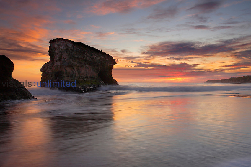 Sea stack at sunset at Natural Bridges State Park, Santa Cruz, California, USA.