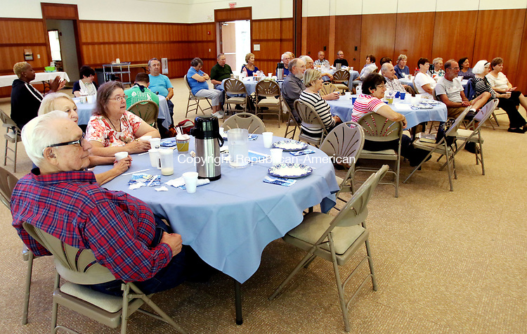SOUTHBURY CT. 09 August 2017-080917SV09-A group listens to Ethel Kaufman of Southbury plays the piano during the Love &amp; Knishes Lunch at the Jewish Federation of Western Connecticut in Southbury Wednesday.<br /> Steven Valenti Republican-American