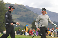 Rory McIlroy (NIR) and Miguel Angel Jiminez (ESP) share a laugh on the 12th during the 1st day of the Omega European Masters, Crans-Sur-Sierre, Crans Montana, Switzerland..Picture: Golffile/Fran Caffrey..
