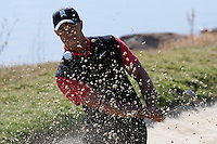 December 4, 2011: Tiger Woods hits out of the sand on the 3rd green during the final round of the Chevron World Challenge held at Sherwood Country Club, Thousand Oaks, CA.