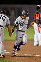 Staten Island Yankees designated hitter Kyle Gray (18) is congratulated by manager Lino Diaz (30) as he rounds third base after hitting a home run in the top of the seventh inning during a game against the Aberdeen IronBirds on August 23, 2018 at Leidos Field at Ripken Stadium in Aberdeen, Maryland.  Aberdeen defeated Staten Island 6-2.  (Mike Janes/Four Seam Images)