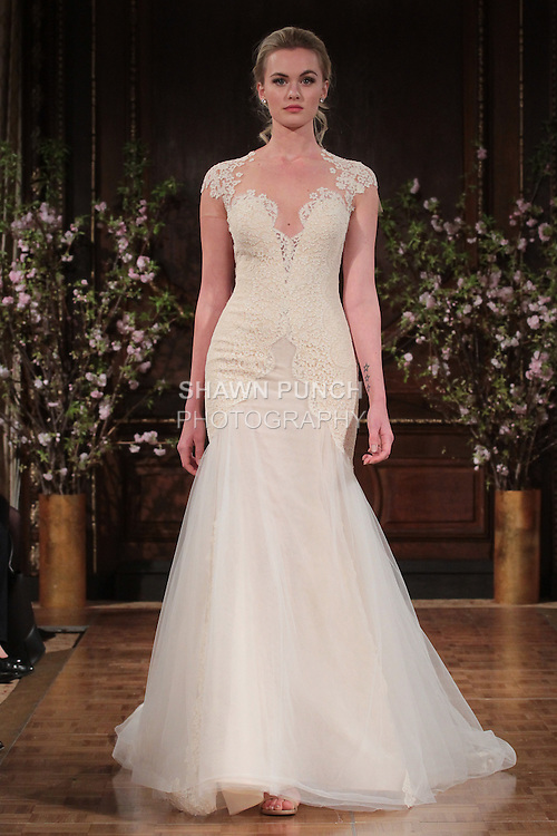"Model walks runway in a ""Toni"" bridal gown from the Isabelle Armstrong Spring Collection 2017, at Lotte New York Palace Hotel, during New York Bridal Fashion Week Spring Summer 2017 on April 16, 2017."