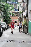 RIO DE JANEIRO; RJ; 24 DE MARÇO 2013 - Corredores disputam as prova de 10k da Corrida Rocinha de Braços Abertos que comemorou o primeiro ano da instalação da UPP na comunidade carioca. FOTO: NÉSTOR J. BEREMBLUM - BRAZIL PHOTO PRESS.