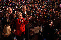 Democratic presidential candidate Hillary Clinton (in red), flanked by (L-R) Rep. Stephanie Tubbs-Jones (D-OH), former senator John Glenn (D-OH), and Ohio governor Ted Strickland, celebrates her victory during a primary election night rally, March 4, 2008, at the Columbus Atheneum, Columbus, Ohio. On this night, Clinton defeated rival Barack Obama to win primaries in Ohio, Texas, and Rhode Island, while Obama won in Vermont. (Kevin Craiglow/PressPhotoIntl.com)