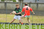 Keith Rolls Curchill tries to get past Dermot Curtin Brosna in the Novice club final at Austin Stack Park on Sunday