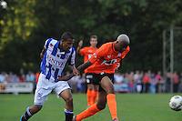 VOETBAL: LANGEZWAAG: Sportpark it Paradyske Langezwaag, 20-07-2013, Oefenwedstrijd SC Heerenveen - AA Gent, Einduitslag 1-1, Luciano Slagveer (#17 | SCH), Valery Nahayo (#5 | KAA Gent), ©foto Martin de Jong
