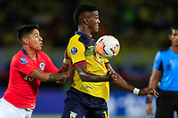 PEREIRA, COLOMBIA - JANUARY 18: Chile's Camilo Moya, (L) fights for the ball  against Ecuador's Jenny Cabeza during their CONMEBOL Preolimpico soccer game at the Hernan Ramirez Villegas Stadium on January 18, 2020 in Pereira, Colombia. (Photo by Daniel Munoz/VIEW press/Getty Images)