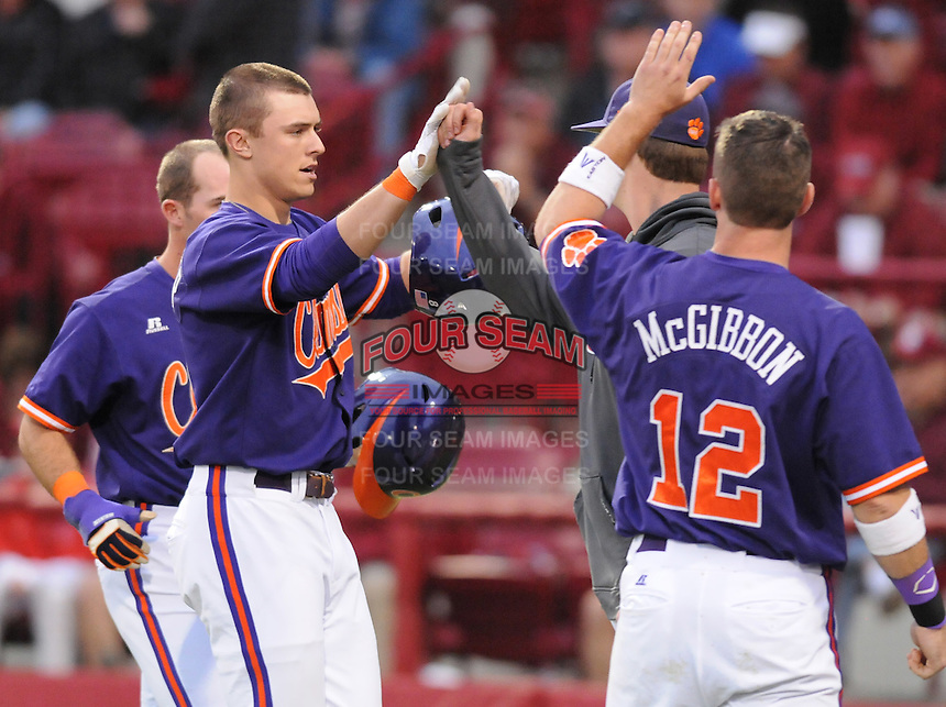 Third baseman Richie Shaffer (8) of the Clemson Tigers is congratulated after hitting a home run against the South Carolina Gamecocks on March 3, 2012, at Carolina Stadium in Columbia, South Carolina. South Carolina won, 9-6. (Tom Priddy/Four Seam Images)