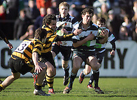 Wallace fullback Philip Wilson is about to be tackled by the McCarthy brothers during the Northern Bank Schools Cup Final at Ravenhill. Result Wallace 0pts R.B.A.I. 15pts.
