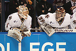 March 25,  2011             Boston College Boston goaltender John Muse (1, left) and Boston College Boston goaltender Parker Milner (35) are both shown on the bench in the waning moments of the game.  Muse started, but was subbed out early in the game, and Milner was pulled so an extra player could take to the ice in an attempt to even the score, very late in the third period. The Colorado College Tigers defeated the Boston College Eagles 8-4 in the second semifinal of the NCAA Division 1 Men's West Regional Hockey Tournament, on Friday March 25, 2011 at the Scottrade Center in downtown St. Louis.