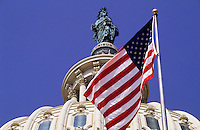 The Capitol with the american flag in Washington DC, USA. Stars and Stripes