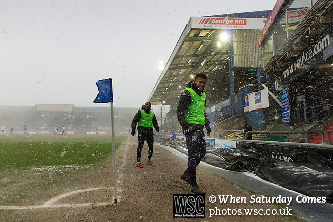 Aaron Holloway of Oldham tries to keep warm. Oldham v Portsmouth League 1