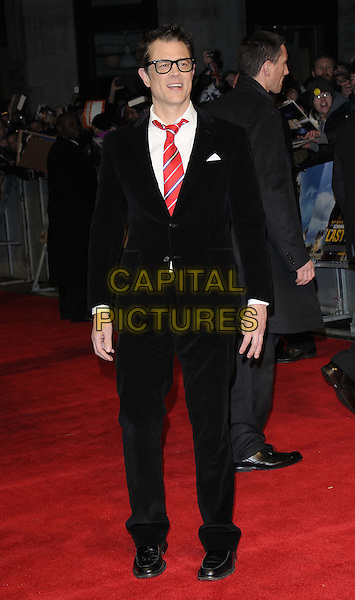 Johnny Knoxville.'The Last Stand' UK film premiere at Odeon West End cinema, Leicester Square, London, England..22nd January 2013.black glasses full length suit white shirt red tie .CAP/CAN.©Can Nguyen/Capital Pictures.