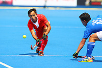 China's Lu Fenghui passes down the wing during the Hockey World League Semi-Final Pool A match between China and Korea at the Olympic Park, London, England on 17 June 2017. Photo by Steve McCarthy.