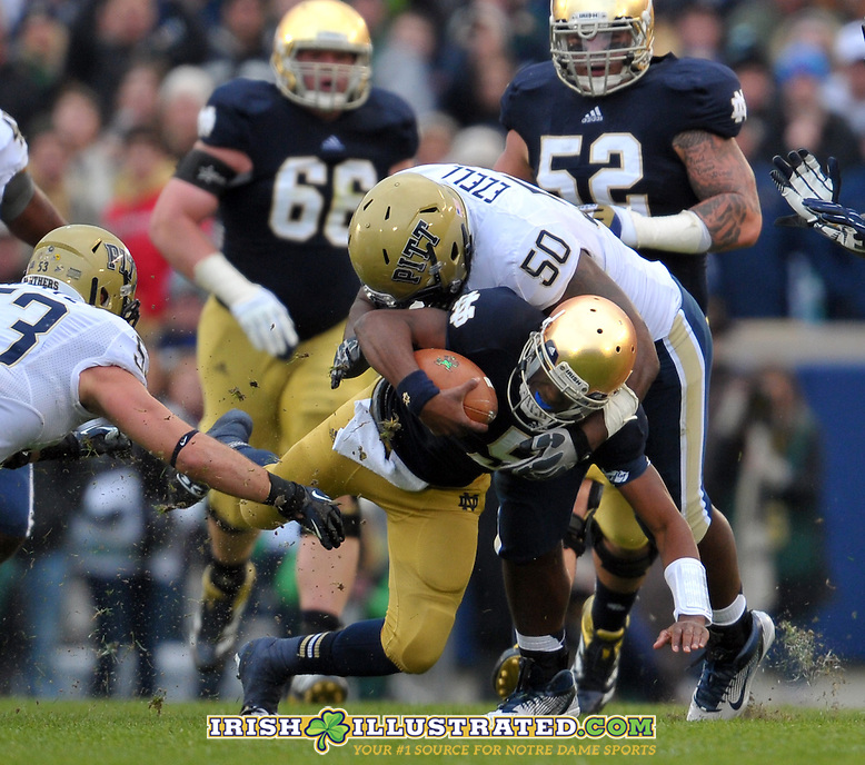Quarterback Everett Golson (5) is tackled by Pittsburgh Panthers nose tackle Tyrone Ezell (50).