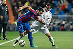 Real Madrid´s Jese Rodriguez (R) and Levante´s Barral during La Liga match at Santiago Bernabeu stadium in Madrid, Spain. March 15, 2015. (ALTERPHOTOS/Victor Blanco)