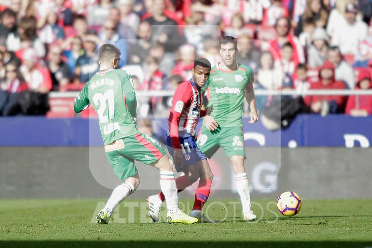 Club Atletico de Madrid's Thomas Lemar and Futbol Club Deportivo Alaves' Martin Aguirregabiria (L), Manu Garcia (R) during La Liga match. December,8,2018. (ALTERPHOTOS/Alconada)