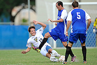 2 October 2011:  FIU midfielder Arnthor Kristinsson (19) dives to intercept the ball from Kentucky midfielder John Mulvany (19) in the second half as the FIU Golden Panthers defeated the University of Kentucky Wildcats, 1-0 in overtime, at University Park Stadium in Miami, Florida.