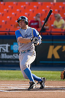 Third baseman Eric Campbell (24) of the Myrtle Beach Pelicans follows through on a solo home run in the top of the 1st inning at Harry Grove Stadium in Frederick, MD, Monday July 14, 2008. (Photo by Brian Westerholt / Four Seam Images)