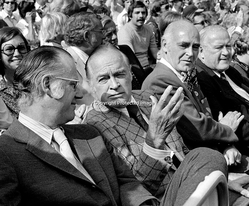 1973 World Series: MLB Bowie Kuhn, Bob Hope, Charlie Finley, and AL Pres. JoeCronin. All sitting behind the Oakland Athletics dugout during the World Series, A's vs. New York Mets. (1973 photo by Ron Riesterer)
