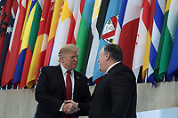 WASHINGTON, DC - FEBRUARY 06:  United States President Donald J. Trump (L) shakes hands with US Secretary of State Mike Pompeo (R) prior to his remarks to Ministers of the Global Coalition to Defeat ISIS at the State Department February 6, 2019 in Washington, DC. The coalitions members gathered in Washington to discuss strategy to combat ISIS. Photo Credit: Alex Wong/CNP/AdMedia