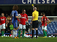 Wednesday 09 January 2013<br /> Pictured: Pablo Hernandez of Swansea (C) is shown a yellow card by match referee Anthony Taylor (R) for his foull against a Chelsea player<br /> Re: Capital One Cup semifinal, Chelsea FC v Swansea City FC at the Stamford Bridge Stadium, London.