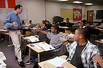 Oakland CA Young math teacher getting seventh-eighth grade geometry students to act out different angles with their arms