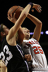 03/11/11--Clackamas' Shelby Vasconcellos-Mattocks is fouled by South Eugene's Jessica Shivers in the semifinals of the 6A girls state championship at the Rose Garden in Portland, Or. The Cavaliers advanced to the championship with a score of 46-35...Photo by Jaime Valdez........................................