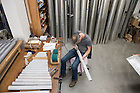 "July 13, 2016; McLeod and Greg Bahnsen might work on dozens of pipes in a single session. Then again, a 16-foot pipe for the organ in the Columbus, Ohio, cathedral weighed 125 pounds and simply burnishing it took a whole day. ""You can do a lot sitting in this chair,"" McLeod quips. (Photo by Barbara Johnston/University of Notre Dame)"