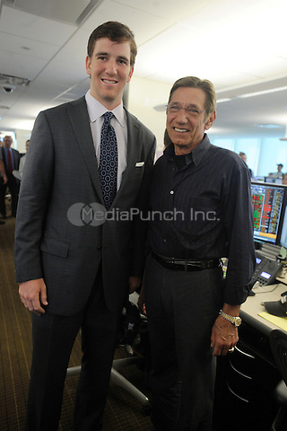 Eli Manning and Joe Namath at BTIG's 9th annual Commissions for Charity day on April 27, 2011 in New York City. Credit: Dennis Van Tine/MediaPunch