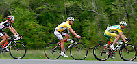 Race leader Floyd Landis (center), of Phonak Hearing Systems, rides between teammate Johann Tschopp (right) and Team CSC's David Zabriskie during Stage 5 of the Ford Tour de Georgia on Saturday, April 22, 2006. Tom Danielson, of the Discovery Channel Pro Cycling Team, won the 94.5-mile (152.1-km) stage from Blairsville to the top of Brasstown Bald, the highest point in the state. Landis finished second and retained the race lead.<br />