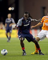New England Revolution midfielder Shalrie Joseph (21) moves on the ball. The New England Revolution defeated Houston Dynamo, 1-0, at Gillette Stadium on August 14, 2010.