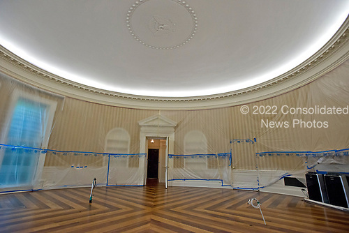 Plastic covers the walls of the Oval Office in the White House West Wing in Washington, DC as it is undergoing renovations while United States President Donald J. Trump is vacationing in Bedminster, New Jersey on Friday, August 11, 2017.  This photo is looking towards the fireplace where toe President has chairs and couches as he hosts meetings there.<br /> Credit: Ron Sachs / CNP