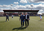 Ally McCoist and Kenny McDowall walking across the Ochilview plastic pitch to take their seats in the dugout for the start of the second half