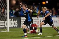 Ellis McLoughlin (25) celebrates his goal over Matt Reis (background) with teammate Steven Lenhart (24) The San Jose Earthquakes defeated the New England Revolution 2-1 at Buck Shaw Stadium in Santa Clara, California on May 21st, 2011.