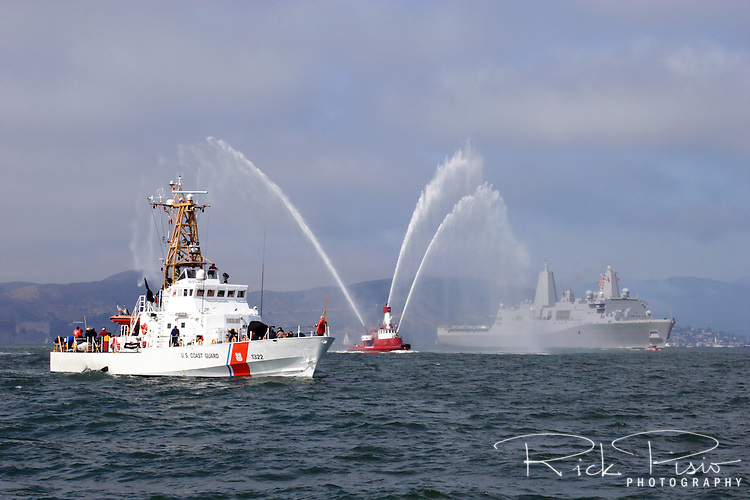 USCG Cutter Cuttyhunk patrols the water of San Francisco Bay while the San Francisco Fireboat Guardian and the U.S. Navy amphibious transport dock USS Green Bay (LPD-20) pass in review during the 2009 San Francisco Fleet Week Parade of Ships.