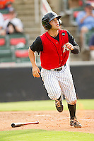 Joey DeMichele (17) of the Kannapolis Intimidators watches the flight of the ball as he starts down the first base line against the Rome Braves at CMC-Northeast Stadium on August 5, 2012 in Kannapolis, North Carolina.  The Intimidators defeated the Braves 9-1.  (Brian Westerholt/Four Seam Images)
